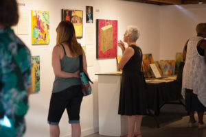 Gallery goers view the Gender Personal exhibit at Kirkland Arts Center.